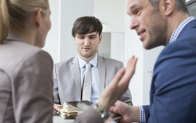 Germany, Saxony, Couple quarrel in front of colleague